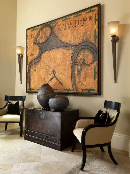 african style living room design nice curtains 33 striking africa inspired home decor ideas digsdigs warm colour palette and dark espresso furnishings with 2 torch wall sconces flanking a