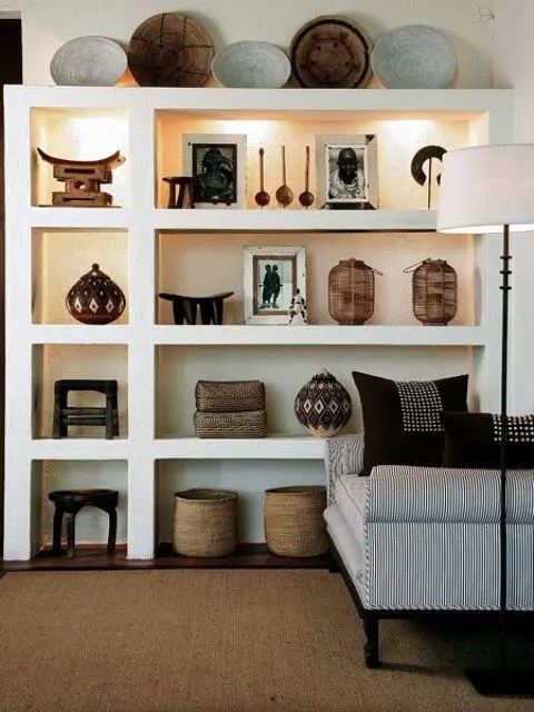 african living room images modern designs 33 striking africa inspired home decor ideas digsdigs pottery and wooden bowls displayed on shelves with hidden lights