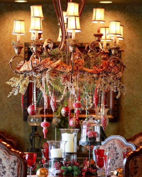 Beautiful Christmas Chandelier With Hanging Red Ornaments Vintage Ribbon And Evergreens