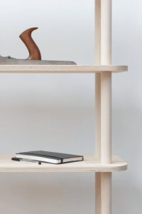 Modular Shelving System On Wooden Rods - DigsDigs