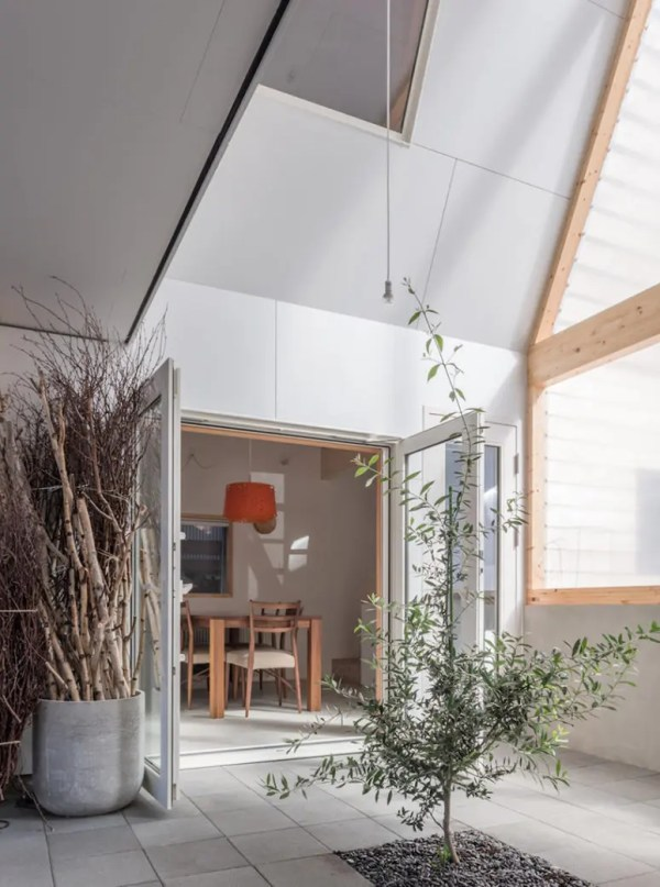 Cost-Effective Japanese Home With An Unusual Facade - DigsDigs