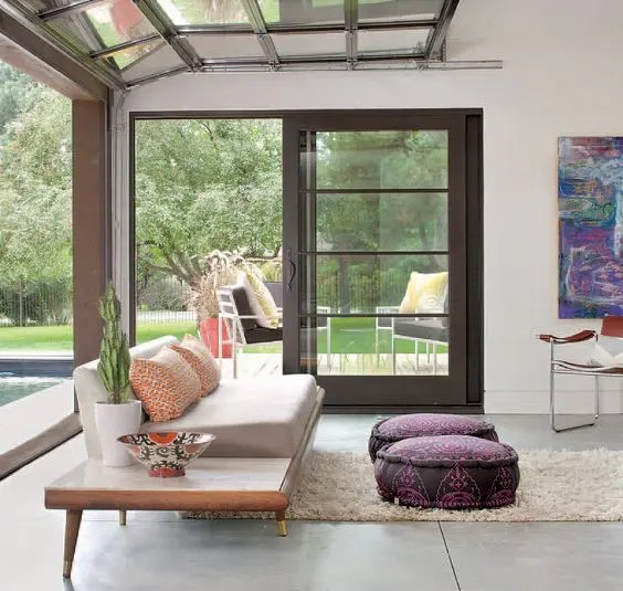 garage door living room with blinds 26 glass ideas to rock in your interiors digsdigs modern roll up design eliminates the border between indoors and outdoors