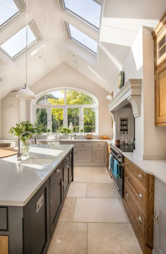 A Modern Looking Vaulted Ceiling With Skylights That Bring Much Light In