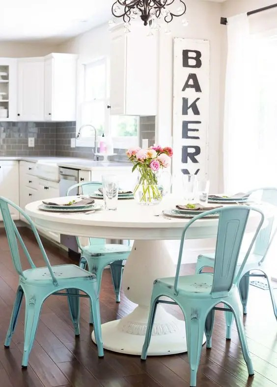 dining table with metal chairs chair covers to rent 25 ways integrate a round pedestal into decor digsdigs chic breakfast nook large white and blue looks very