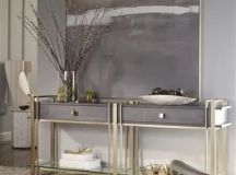 The artwork over the console table is slightly shorter on both sides