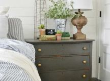 a rustic grey dresser to add a cozy feel and give you mcuh storage space
