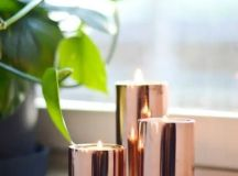an arrangement of copper candle holders is a chic addition to any space