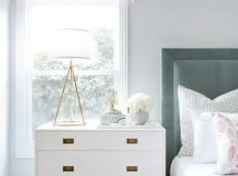a sleek white dresser will fit many bedroom styles and looks and metallic handles
