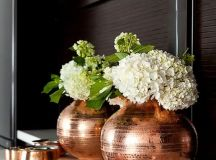 a copper vase and some cute copper catch all trays will add chic to your entryway or bedroom