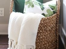 a large basket with blankets and pillows is ideal for a bedroom