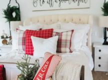 a wicker basket, some red and plaid touches and neutral bedding for a cozy farmhouse bedroom
