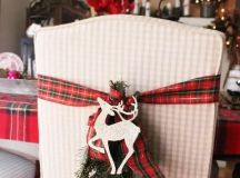 plaid ribbons with evergreens and deer for chair decor and a plaid tablecloth