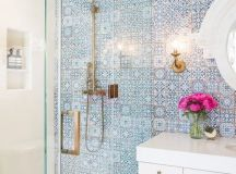 a statement mosaic tile wall in blue to make your bathroom more eye-catchy