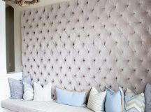 a whole wall upholstered with blush velvet guarantess a glam and girlish feel in the space