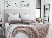 white and grey bedding with blush and dusty pink touches