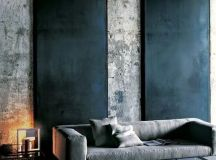 a moody space can be accentuated with blackened metal wall panels on raw concrete walls