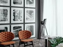 a regular gallery wall in black and white adds style and a retro feel to the space