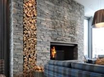 highlight your fireplace with a whole sone clad wall with firewood storage
