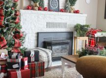 wide plaid ribbons on the Christmas tree, a plaid tablecloth and lots of evergreens for rustic decor