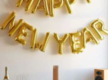 a gold balloon garland can be made by you and will decorate any zone or space