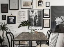a stylish black and white retro-inspired gallery wall for a dining space