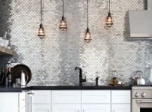 shiny metallic tiles that take a whole wall are ideal to add a glam feel