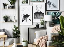 a gallery wall with tropical leaves that echo with real greenery around