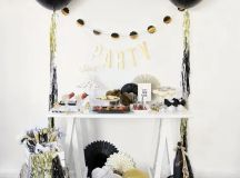 colorful fringe and black, gold and white balloons around will make any space party-like
