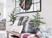 a eucalyptus garland and a faux evergreen wreath is all you need for an entryway