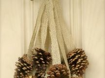 a burlap and pinecone door decoration can be hung on a door, mantel or railing