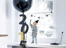 a large balloon with fringe and numbers for cool and simple New Year's decor