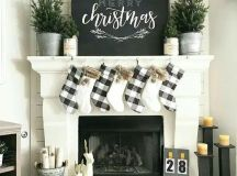 buffalo check stockings and evergreens in buckets for a chic farmhouse mantel