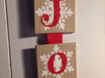 a JOY burlap sign with snowflakes and red letters will decorate any door or mantel