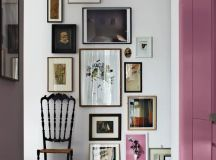 a create artwork arrangement in a vintage entryway with artworks placed on the floor, too