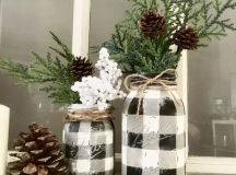 buffalo check vases of mason jars with evergreens and pinecones can be DIYed by you