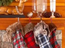 colorful plaid stockings with faux fur are what you need for a cozy winter mantel