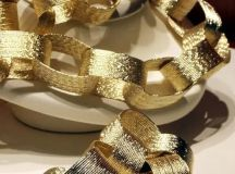 a shiny gold chain garland for a glam and glitz New Year party