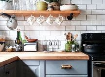 classic white subway tiles will look great in many different kitchens including such a modern rustic space