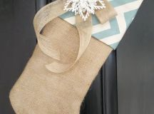 a burlap stocking with chevron decor, a snowflake and a burlap bow for front door or mantel decor