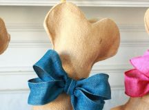 creative dog bone stockings with large bows for a home of dog lovers