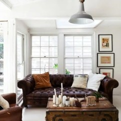 Living Rooms With Brown Couches Best Place To Purchase Room Furniture 25 Ways Integrate A Chesterfield Sofa Into Your Interior Digsdigs Creamy Sunroom Dark Leather And Vintage Chest For Storage