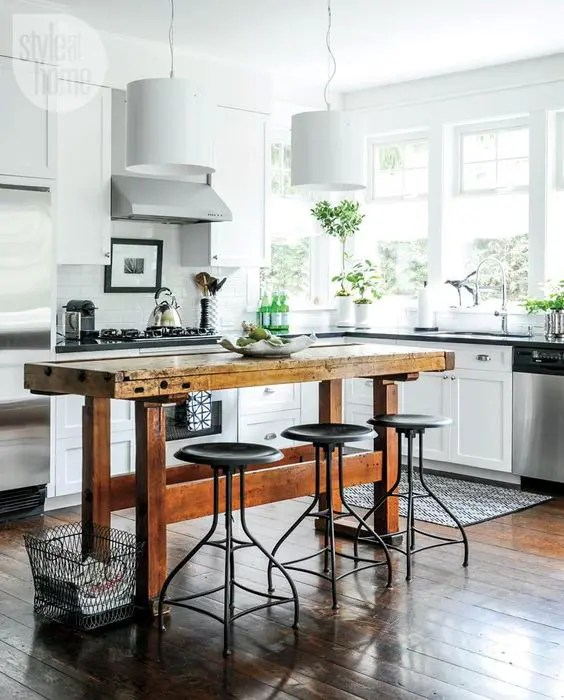 kitchen workbench light maple cabinets 25 industrial islands to make a statement digsdigs vintage wooden table with horizontal beams and metal stools create an look spruce