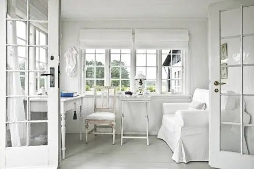 all white scandinavian sunroom