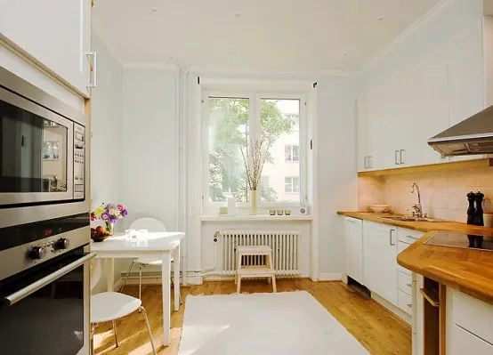 Apartment with Light Wood Floors  Painted White Walls