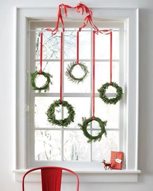 awesome christmas window decor ideas several hanging wreaths would make a striking impact on your windows look