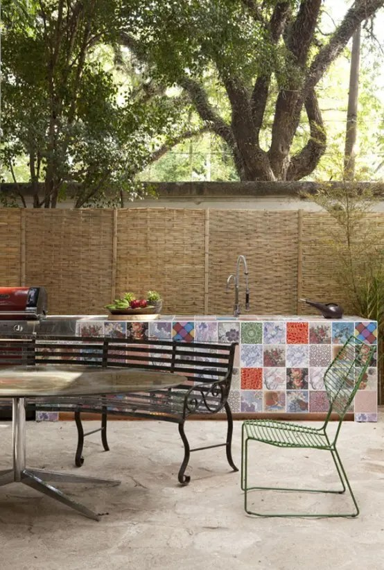 Here is an awesome idea to use different patchwork tiles to make your outdoor kitchen more interesting and fun.