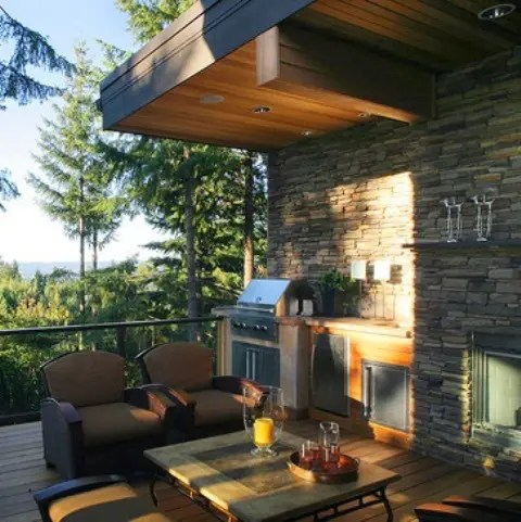 Installing an outdoor kitchen on a deck with a view is a great way to make the cooking process much more pleasant.