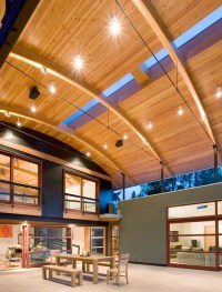 House Made Of Eclectic Materials with Arched Metal Roof