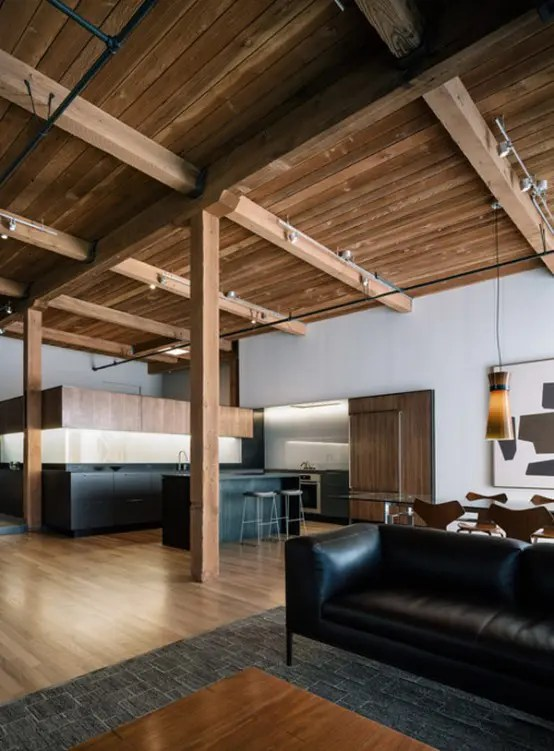 Modern Loft Renovation With Lots Of Wood In The Decor