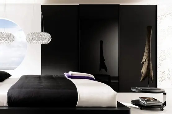 Ultra-luxury-modern-bedroom-with-black-bed-wardrobe-and-bedside-table-and-marvelous-chandeliers